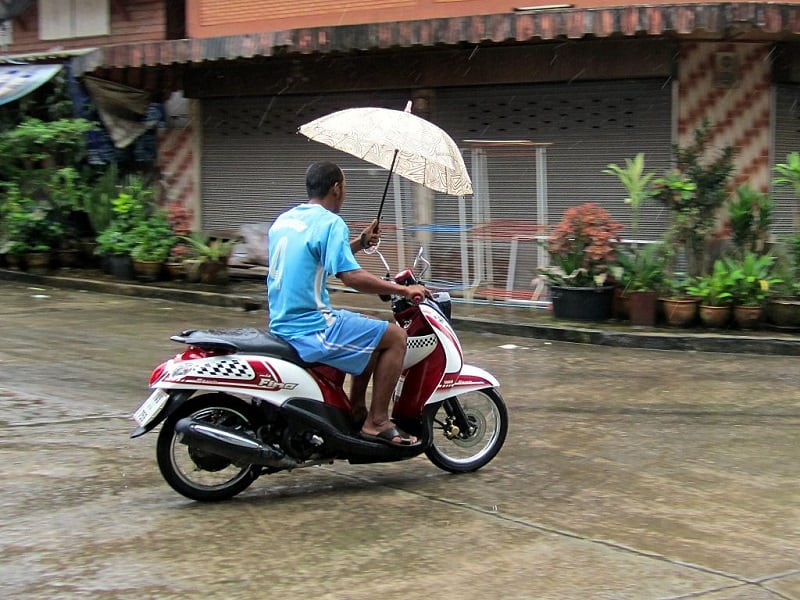 motorcycle scooter in the rain