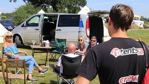 Friends enjoying their intentsGP pre erected camping tent at the British F1 Grand Prix